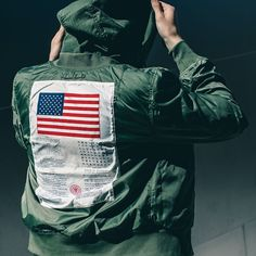 Get your wings. The Dragonfly Blood Chit Flight Jacket pays tribute to a fascinating piece of military history. Mens Flight Jacket, Military History, Style Guides, Blood, 1, Men's Jacket, Jackets, Wings, Green