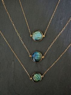 Labradorite bezel gemstone necklace with so much color and fire (iridescent sheen Labradorite is known for.) Every piece has lots of fire and is truly one-of-a-kind.