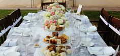 Baby shower table settings with tiered sandwich display and floral bouquets.   #babyshower