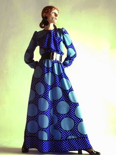 Christian Dior, S/S 1970. A model displays a long blue spotted dress, wide belt and blue and white doted scarf as part of the Christian Dior Haute Couture collection.
