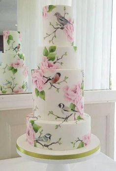 Hand painted wedding cake featuring illustrations of British garden birds. tall 4 tier cake in pink and sage green. Hand painted with cocoa butter paint. Design by Emily Hankins Cakes Hand painted wedding cake featuring illustrations of British garden bir Crazy Wedding Cakes, Creative Wedding Cakes, Small Wedding Cakes, Black Wedding Cakes, Floral Wedding Cakes, Wedding Cake Rustic, Beautiful Wedding Cakes, Wedding Cake Designs, Wedding Bride