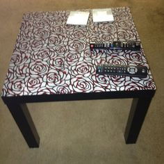 Recovered my black coffee table from Ikea with fabric using mod podge. Only took a couple coats. So simple and so fancy.
