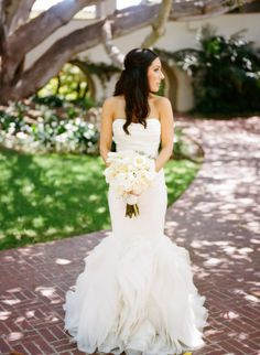 Bride in a ruffled Vera Wang gown http://www.verawang.com | Photography by erinheartscourt.com | Floral Design and Decor by nicosb.com |   Read more - http://www.stylemepretty.com/2013/07/09/santa-barbara-wedding-from-erin-hearts-court/