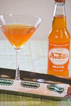 Liquid Creamsicle        7 oz orange soda    (3 oz Pinnacle whipped cream vodka    whipped cream to garnish)