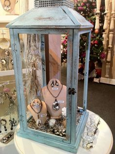 Large lantern re-purposed for jewelry display.....lovely