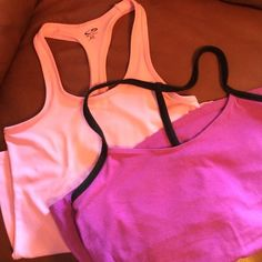 Workout top Bundle 2 for 1 Workout top bundle. Pink is XS Champion. Purple is a M Yoga with self bra. Not padded. Both in good used condition. No rips or stains. Tops