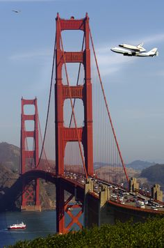 Space Shuttle Endeavor flying out to sea over the Golden Gate Bridge by Adam Rutkowski