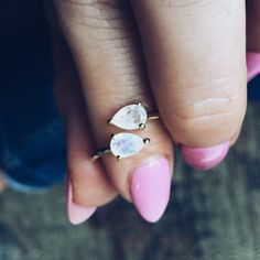 A one size fits all adjustable ring. Two pear shaped, glowing moonstones are prong set on a 24K gold vermeil band. Moonstones are a powerful gem that feature an inner glow of a bluish purple. - 24K go