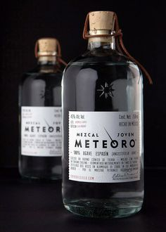"Metero - hand-made quality mezcal. ""... The recycled blown glass bottle features a premium natural cork, a hand-tied leather harness and a high-end, embossed cotton paper label."" Just enough detail, something quite special about this. I want some purely for the bottle."