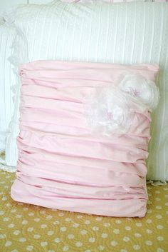 Pink Pleated Pillow - Tutorial: Very pretty in pink. Go here for the candle singed flowers.  http://tinyurl.com/23sfpqh