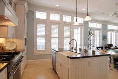 plantation shutters 3 windows with single doors. Like what will be in our dining room