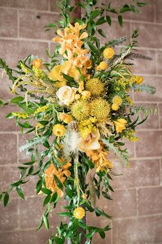 How pretty is this bright yellow summer flower arrangement? We added these florals to an industrial wedding arch. Check out our blog for more details from this intimate wedding. Spring Wedding Destinations, Destination Wedding Planner, Summer Flower Arrangements, Summer Flowers, California Wedding Venues, Spring Wedding Inspiration, Outdoor Wedding Venues, Ceremony Backdrop, Festival Wedding