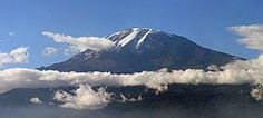 Mount Kilimanjaro  Located in Tanzania.  I don't want to climb it just see it!!!!