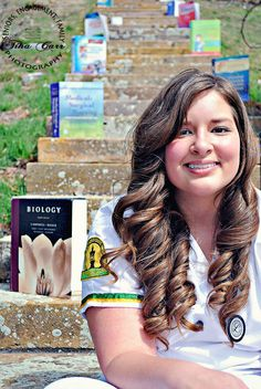 I definitely want a graduation picture with all of my books that I have from going through nursing school.