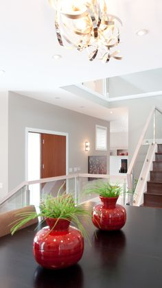 We specialize in home staging for vacant homes.  Our developer client chose this interesting design for the dining room and carried the creation to the other grand rooms of the home. Glass railings were also found throughout this home. www.privatepropertystaging.com