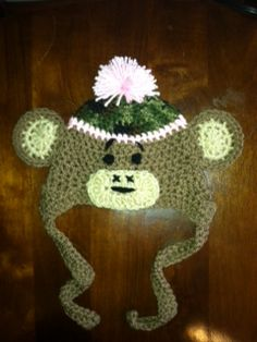 """All crochet hats can be found on our facebook page """" Idle Hands Crafters """". We can do any size! Camo monkey can be made with any color trim too!"""