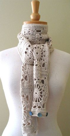 Eclectic Me shared this buttoned crochet scarf. Click through to see how it looks when buttoned into an infinity scarf.