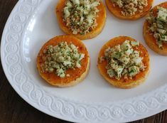 Butternut Squash Rounds with Hazelnut-Apple Gremolata - Who knew the simple butternut squash could be so stunningly gorgeous? Serve this healthy appetizer or side dish at your next gathering - your guests will thank you! Plus 23 more Scrumptious Butternut Squash Recipes!