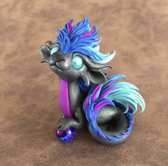 Fluffy Silver and Neon Dragon by Dragonsandbeasties