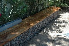 Gabion Walls - What They Are And How To Use Them In Your Landscape- I like the idea of making the wall into a usable bench