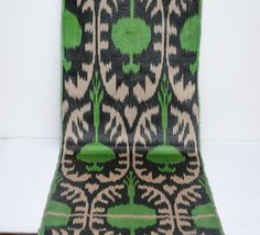 Green beige black ikat fabric by the yards, stylized pomegranate design