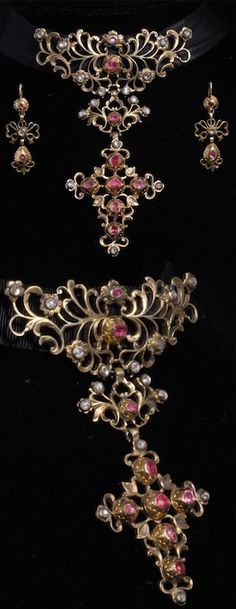 """*Parure, 18th century silver-gilt, diamonds and rubies. This rare set comprises a hinged pendant-cross and a pair of ear """"pendants"""". The set is in vermeil, set with small diamonds cut to """"roses"""" and rubies and in very good condition, with its original gilding.  French work towards 1750-1760. #RubyParure"""
