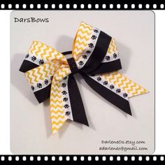 cf470d10bd9991 Black with Gold n White Chevron ad Paw Prints finished with a Black Glitter  Center Hairbow