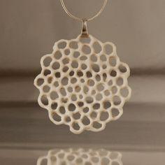 Ceramic Necklace - Syringe porcelain slip into pattern -- printed pattern under plastic wrap.