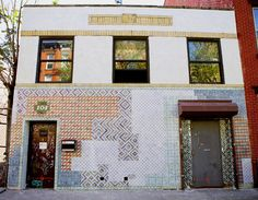"""Attention street art aficionados: a new public work by Faily has landed in Williamsburg! The piece, quite practically titled """"104 N. 7th,"""" departs from the usual pop-art look the duo is best known for and features instead thousands of hand-painted, sculpted ceramic tiles covering the facade of a commercial building."""