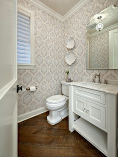 Wide plank wood flooring laid diagonally.  Gives movement and style to the space.  Instant warmth to the otherwise pretty white powder room.
