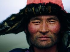 A man in western Mongolia wears a fur-trimmed hat as protection from the bitter cold of winter. Sprawled across mountains and plateaus, Mongolia has an average elevation of 5,180 feet (1,580 meters).