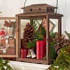 50 Gorgeous Holiday Mantel Decorating Ideas Transform your mantel into a focal point using our ideas for easy Christmas decorating. See how to decorate your mantel with ornaments, evergreens, pine cones, holiday figures, stockings and more. Christmas Lanterns, Noel Christmas, Country Christmas, Simple Christmas, Christmas Crafts, Beautiful Christmas, Christmas Fireplace, Fireplace Mantel, Decorating Lanterns For Christmas