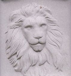 This lion sculpture appears in bas relief on a monument at Oak Hill Cemetery in Glendale, Ohio. | Lion sculpture