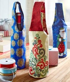 Create the gift of wine or a food item more festive by stitching these lovely fabric bags designed by Joyce Decunzo to carry and deliver to the lucky recipient!