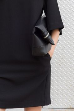 Chic Style - simple black dress & leather clutch | @andwhatelse