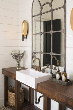 Country Powder Room with Powder room, Wall sconce, specialty door, High ceiling, Signature Hardware Balsa Semi-Recessed Sinks