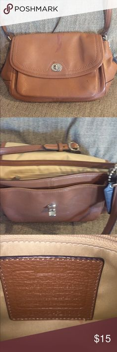 Coach Satchel Brown coach satchel purse. It has a nail polish stain in the front and pen stains. Never tried to remove the stain, not sure if it can be removed. Authentic coach purse bought from a coach outlet. Coach Bags Satchels