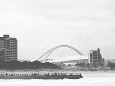 A view of the pier and Moses Mabhida Stadium in Durban, South Africa. Sydney Harbour Bridge, Dory, South Africa, Explore, Travel, Viajes, Destinations, Traveling, Trips