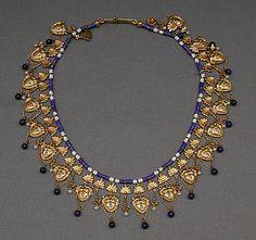 -Circa 1870 Necklace with Satyr's-head pendants by Carlo Giuliano (Italian, active England, ca. 1831–1895). Gold, lapis lazuli, pearls, enamel.