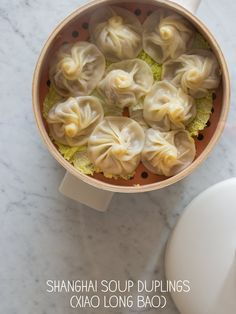 """Shanghai Soup Dumplings. Refrigerate chicken stock mixed with gelatin til it solidifies to get the """"soup"""" inside of the dumplings.  Ingenious!"""