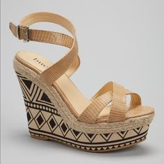"Tribal Print Wedges - True to size, open toe - Crisscross vamp - Embossed with patent finish - Adjustable ankle strap - Buckle closure - Braided rope detail - Tribal print - Wedge heel - Approx. 5"" heel, 2"" platform - Manmade upper and sole Bucco Shoes Wedges"
