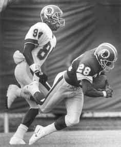 Darrell Green intercepts a pass in practice intended for Gary Clark.