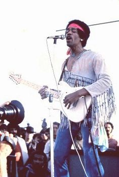 Jimi Hendrix as featured in Jimi Hendrix Live at Woodstock Alblum's 12x12 36 page Promotional book commemorating the 35Th Anniversary of Jimi's performance at the Woodstock Festival; also, as exhibited in Santa Fe, San Francisco, Rotterdam and London; as well as in Barry's private collection autograped for exhibit and sale