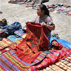 Mayan woman selling native fabric  Near the Nunnery in Antigua, Guatemala
