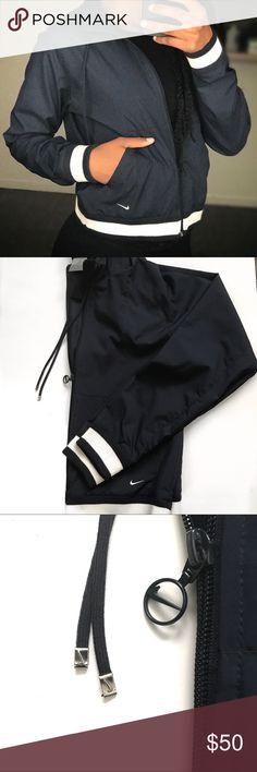 Vintage Nike Windbreaker Navy Blue no flaws. slim fit with lots of logo detailing. Nike Jackets & Coats