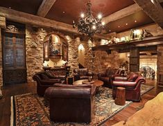 Love the walls, beams and painted ceiling color. Also notice the 5 easy chair arrangement