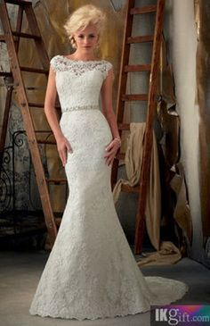 A stunning lace wedding dress which is simple and elegant - Don't know why I love it, but I just do.