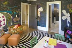 Fun, whimsical play room design with black chalkboard walls Ikea Stockholm Rand white & black rug, gray silk roman shades, green chairs, white table and orange slipper chairs & ottoman. Black Chalkboard Paint, Chalkboard Walls, Blackboard Paint, Chalkboard Decor, Magnetic Chalkboard, Magnetic Wall, Ikea Stockholm Rug, Trofast Ikea, Kind Und Kegel