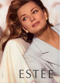 Paulina Porizkova looking good in light grey.