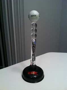 """Funny golf award - last place plunger trophy. Dollar store plunger and golf ball glued on top. Last place stickers. Won't feel so """"down in the dumps"""" when coming in last."""